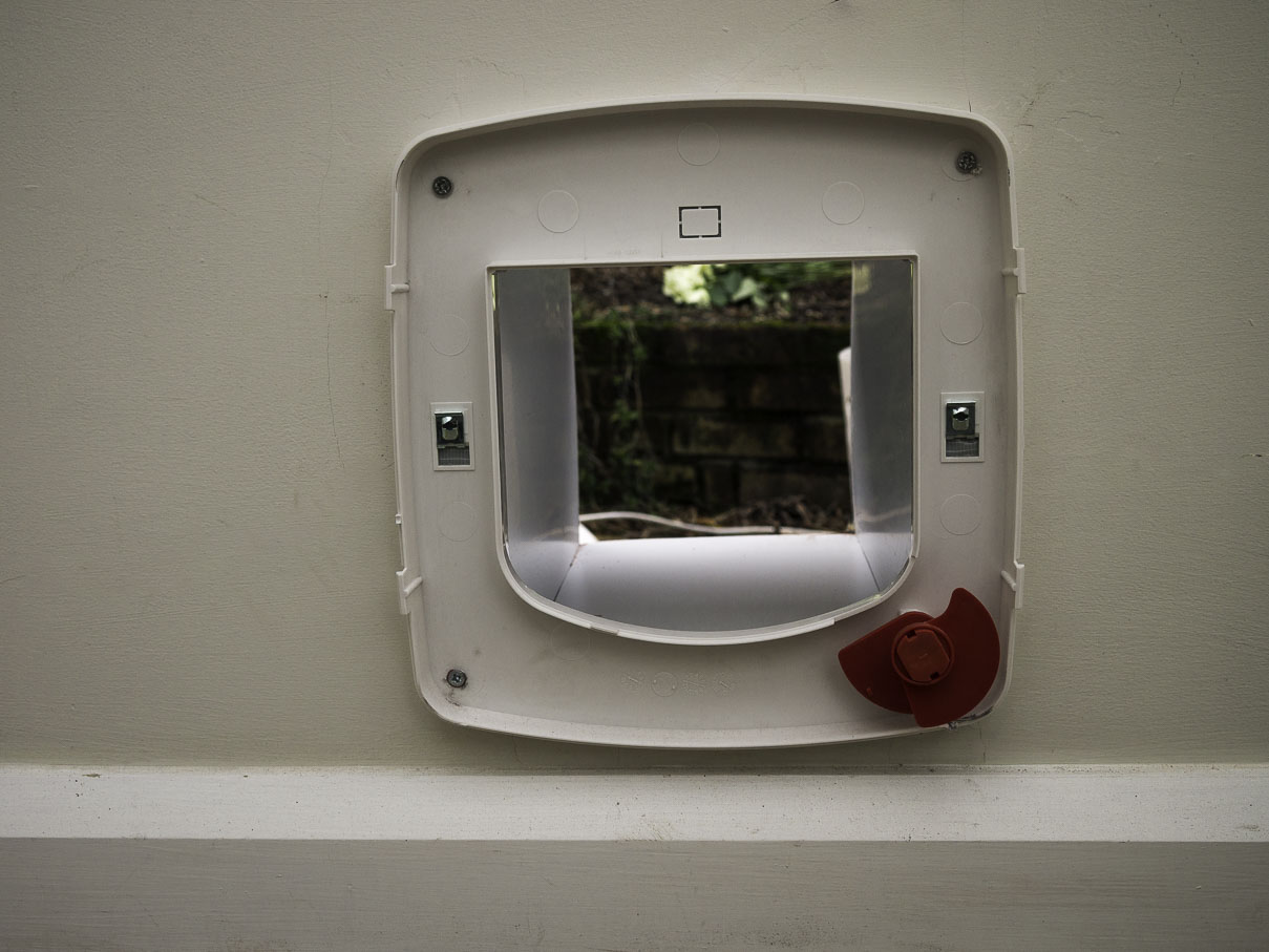 cat flap front is removed to fix it to the wall